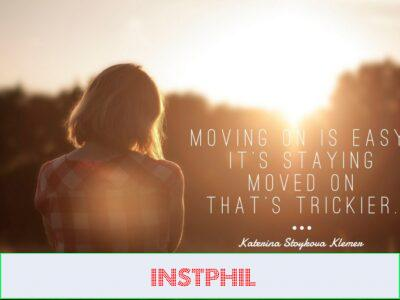 A girl in a checked shirt walking down a road at sunset with moving on quote